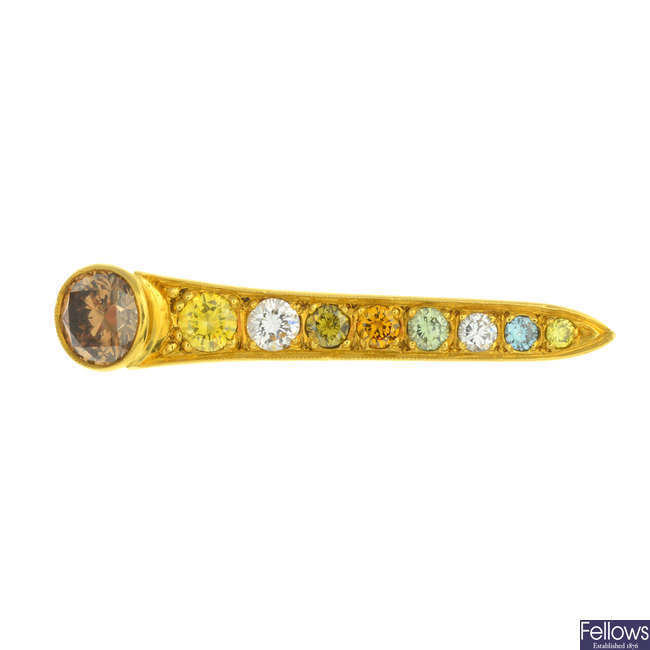 An 18ct gold coloured diamond and diamond nail brooch.