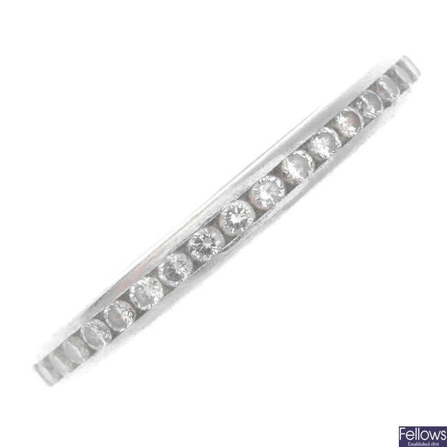 TIFFANY & CO. - a platinum diamond full eternity ring.