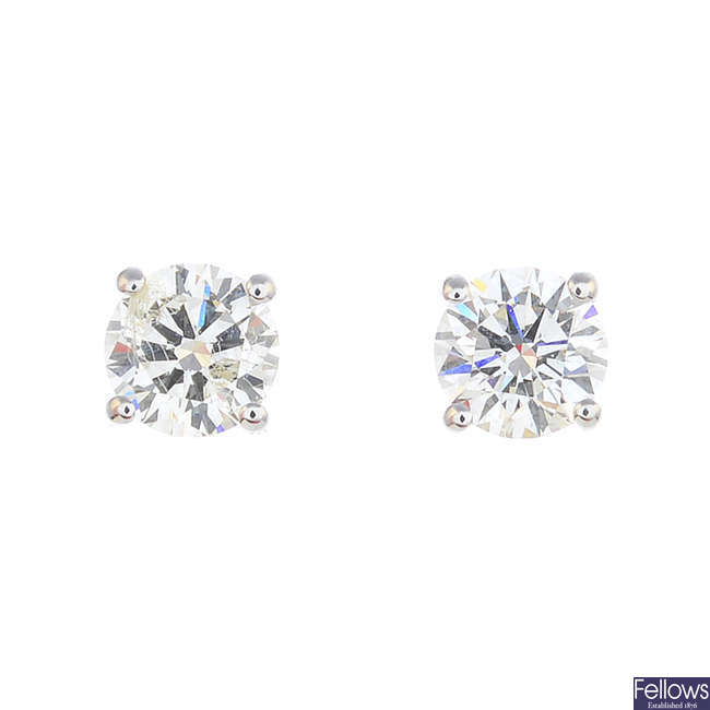 A pair of 9ct gold brilliant-cut diamond stud earrings.