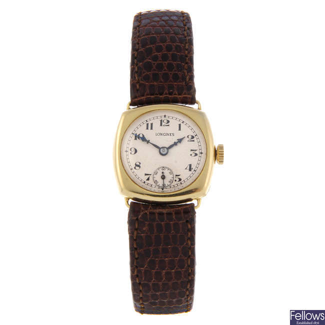 LONGINES - a lady's yellow metal wrist watch.