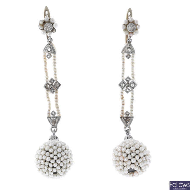A pair of early 20th century seed pearl and diamond earrings.