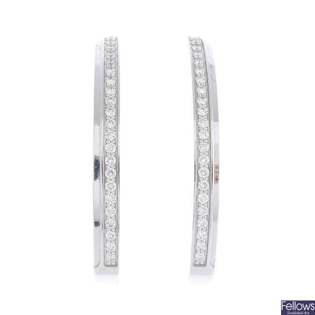 PIAGET - a pair of diamond earrings.