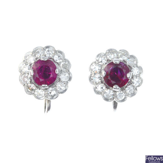 A pair of early 20th century 9ct gold ruby and diamond floral cluster earrings.