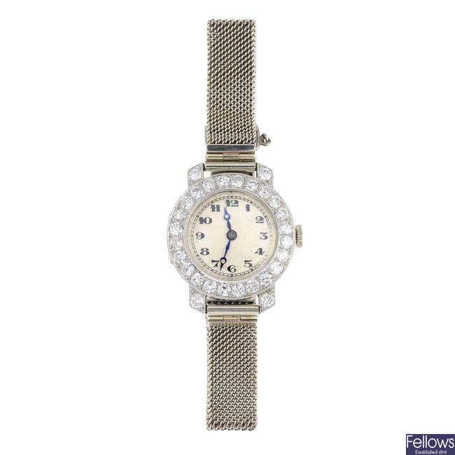 VERTEX - a lady's early 20th century platinum diamond cocktail watch.