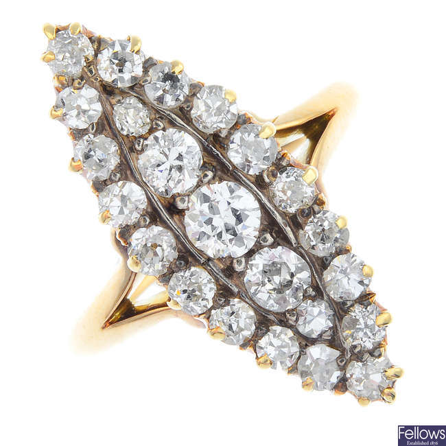 An early 20th century gold diamond cluster ring.