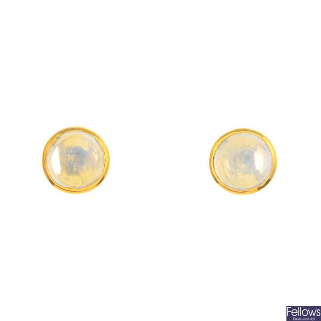 A pair of moonstone single-stone earrings.