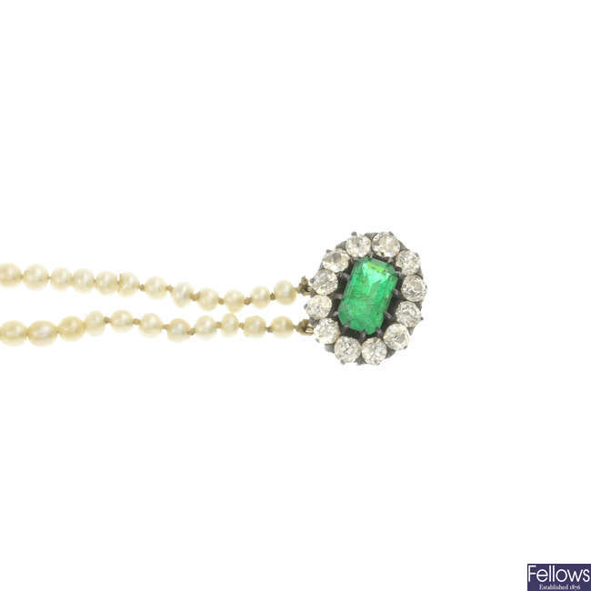 A pearl three-strand necklace, with emerald and diamond clasp.