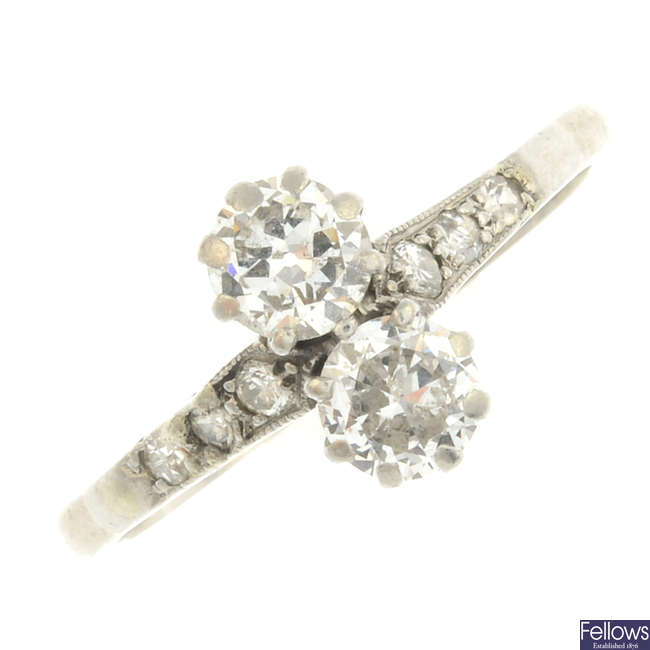 A diamond two-stone ring.