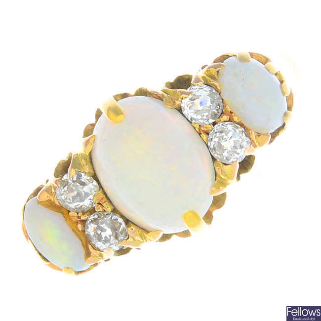 A late Victorian 15ct gold opal three-stone and diamond ring.