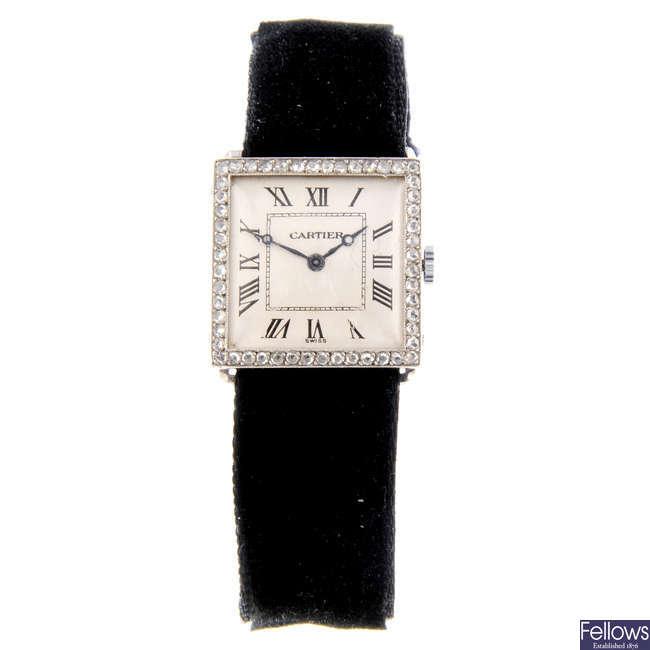 CARTIER - a white metal wrist watch.