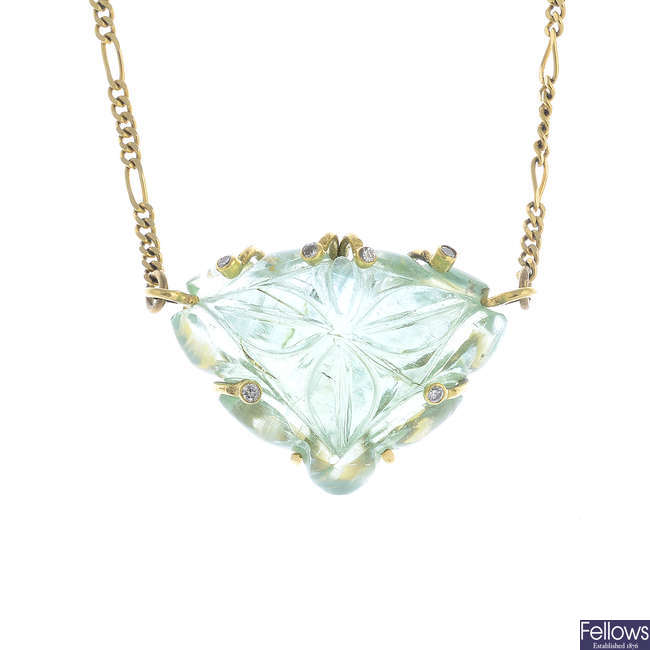 A 9ct gold beryl and diamond pendant, on chain.