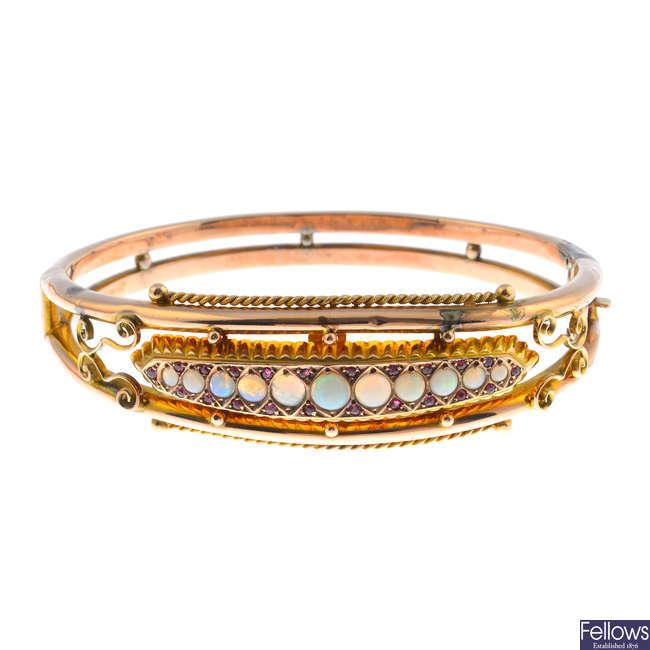 An Edwardian 9ct gold opal and gem-set  bangle.