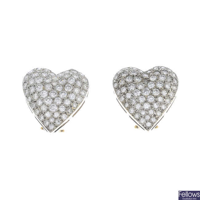A pair of diamond heart earrings.