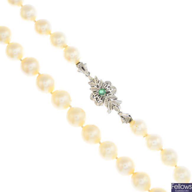 A cultured pearl single-strand necklace, with emerald clasp.