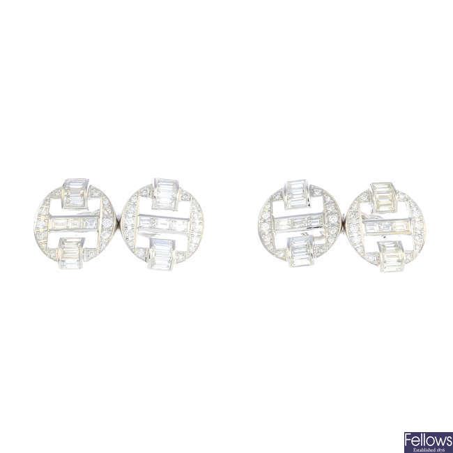 A pair of diamond cufflinks.