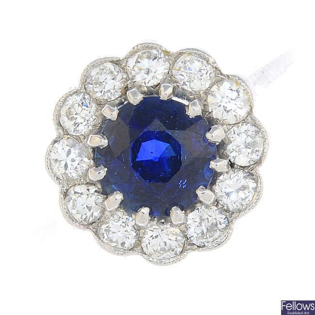 A Sri Lankan sapphire and diamond cluster ring.