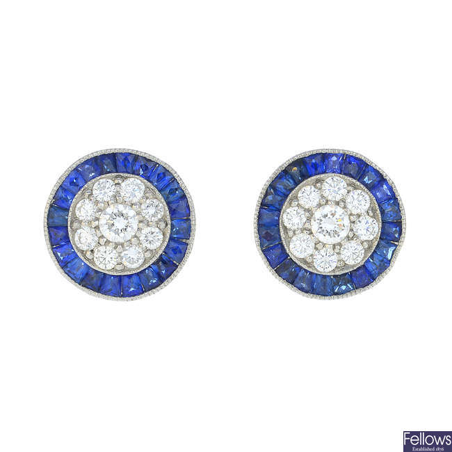 A pair of diamond and sapphire cluster earrings.