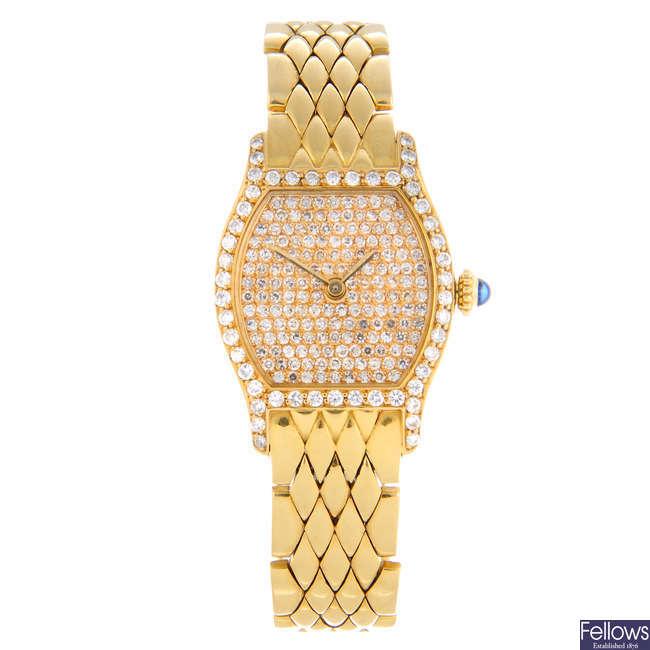 CARTIER - an 18ct yellow gold diamond set Tonneau bracelet watch.
