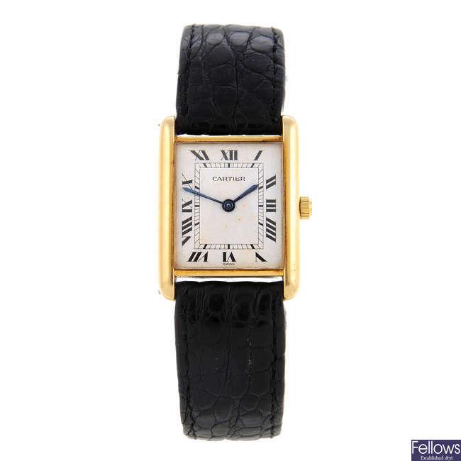 CARTIER - a yellow metal Tank wrist watch.