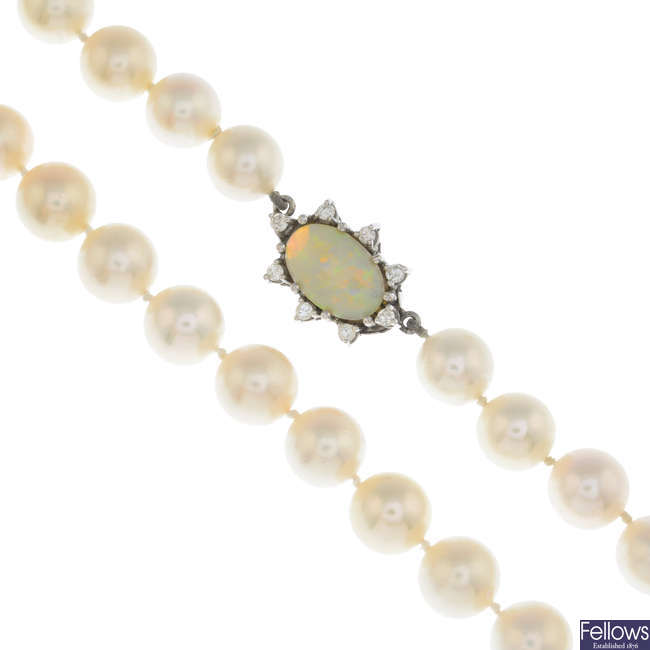 A cultured pearl single-strand necklace, with opal and diamond clasp.