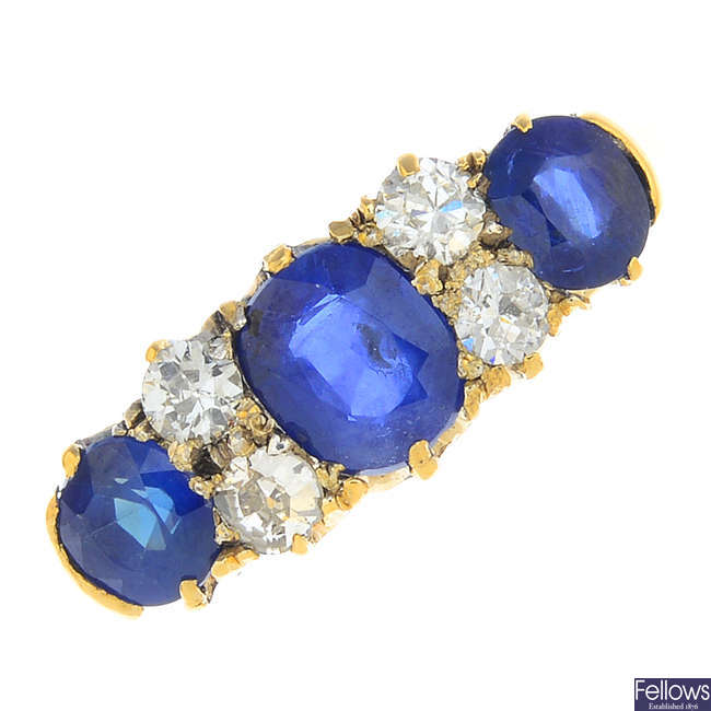 An early 20th century 18ct gold sapphire three-stone and diamond ring.