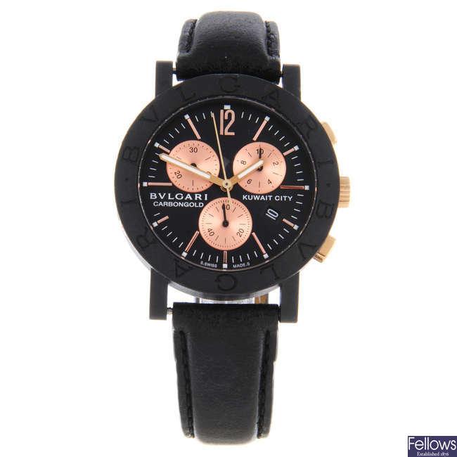 BULGARI - a limited edition gentleman's carbon fibre Carbon Gold Kuwait City chronograph wrist watch.