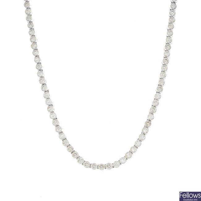 An 18ct gold diamond line necklace.