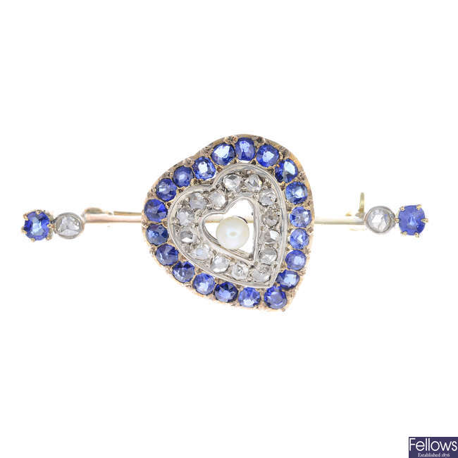 An early 20th century gold sapphire and diamond heart brooch.