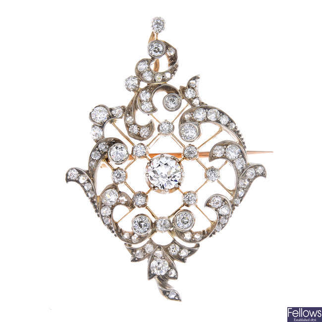 A late 19th century silver and gold diamond pendant.