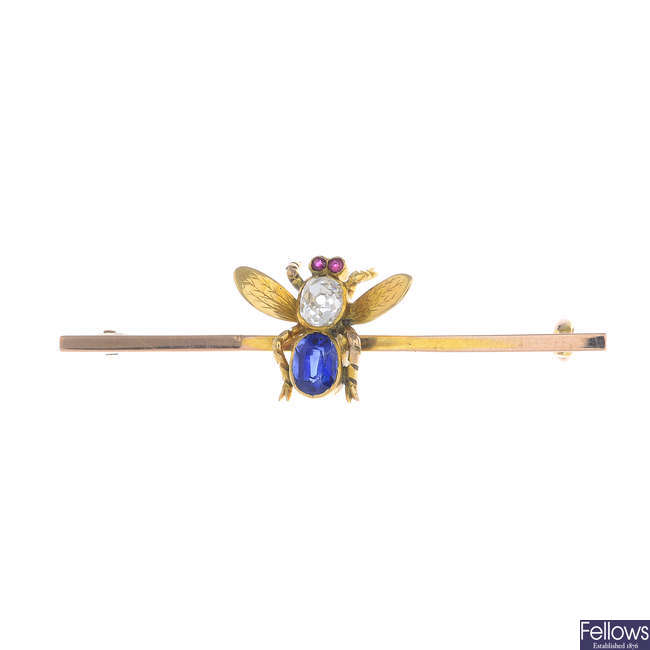 An early 20th century gold diamond, sapphire and ruby fly brooch.