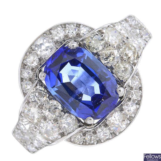 A mid 20th century platinum sapphire and diamond ring.