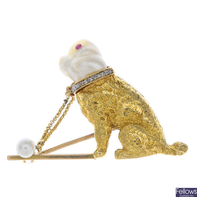 An early 20th century 18ct gold baroque cultured pearl and diamond dog brooch.