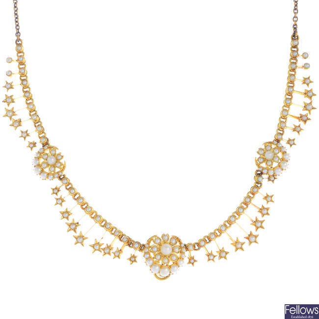 An early 20th century gold split and seed pearl necklace.