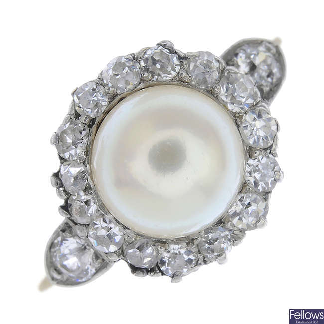 An early 20th century gold cultured pearl and diamond cluster ring.