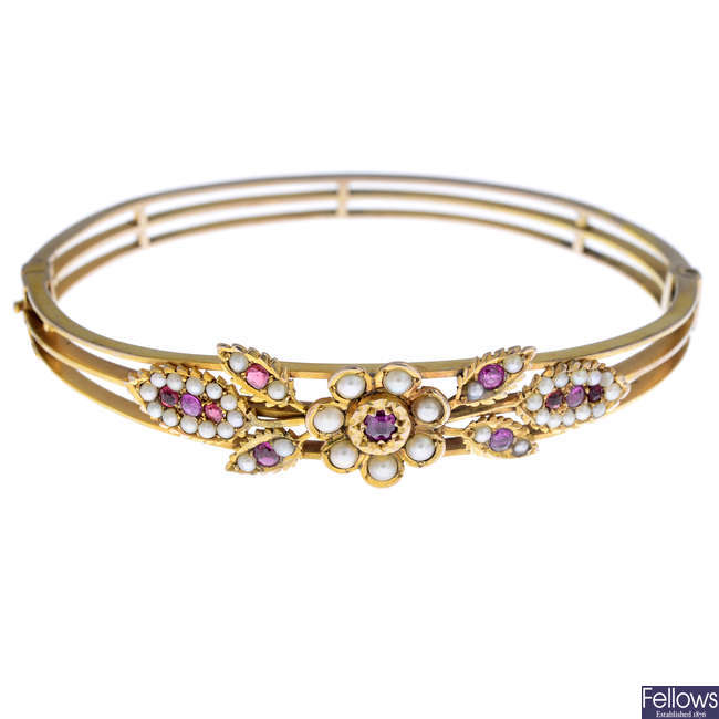 A ruby and split pearl hinged bangle.