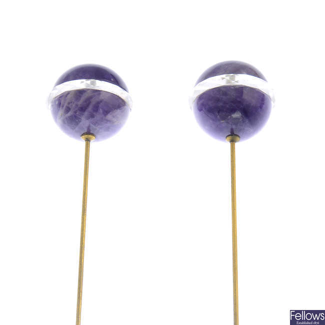 A pair of early 20th century amethyst and rock crystal hatpins.