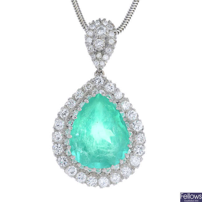 A Colombian emerald and diamond pendant, with chain.