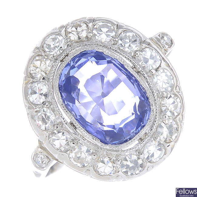 A sapphire and diamond cluster ring.