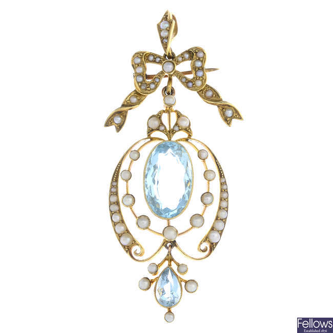An early 20th century 15ct gold aquamarine and split pearl pendant.