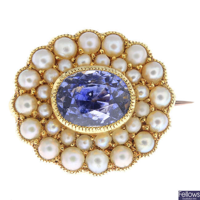 An early 20th century 15ct gold Sri Lankan sapphire and split pearl brooch.