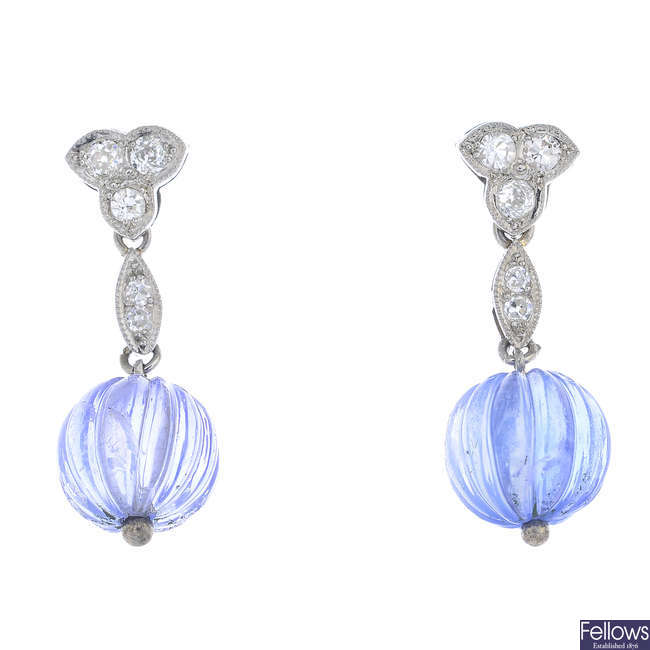 A pair of platinum and gold, sapphire and diamond earrings.