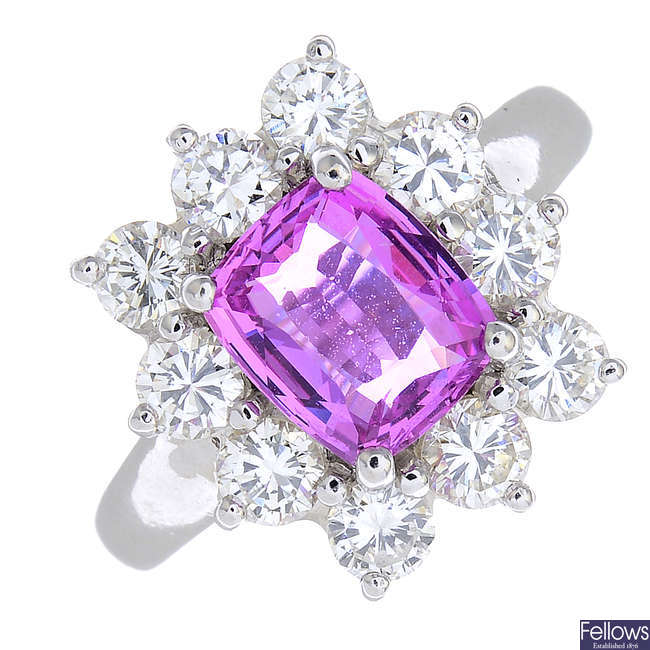An 18ct gold pink sapphire and diamond cluster ring.