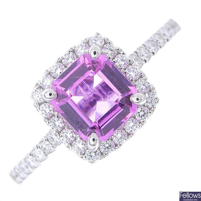 A pink sapphire and diamond cluster ring.