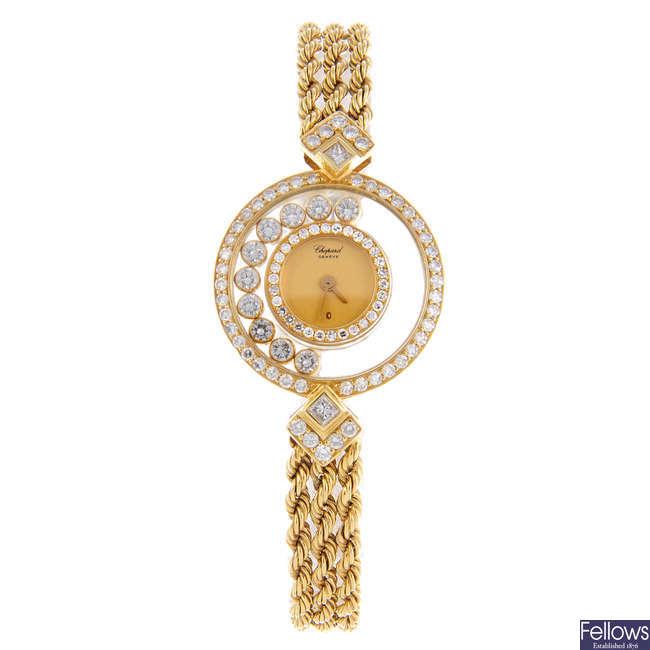 CHOPARD - a lady's yellow metal Happy Diamonds bracelet watch.