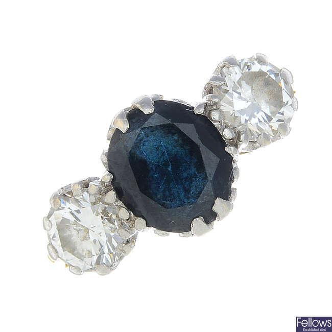 A sapphire and diamond three-stone ring.