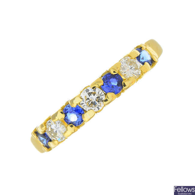 An 18ct gold sapphire and diamond half-eternity ring.
