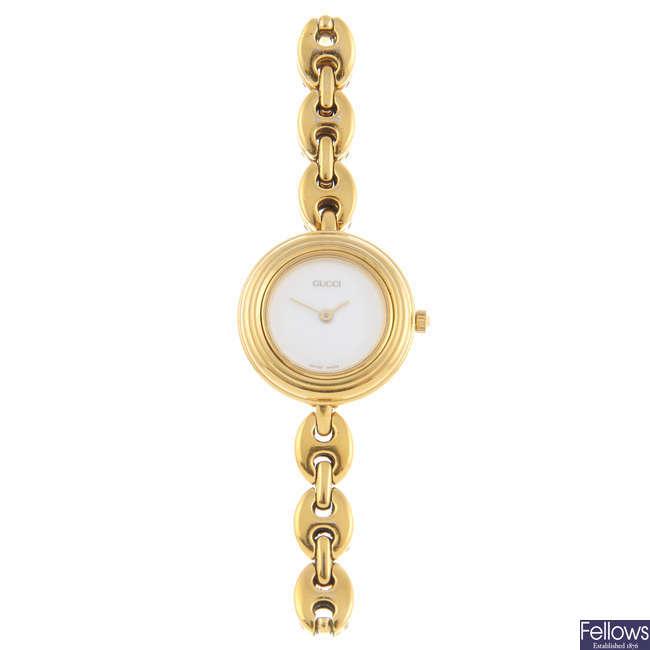 GUCCI - a lady's gold plated 11/12.2 bracelet watch.