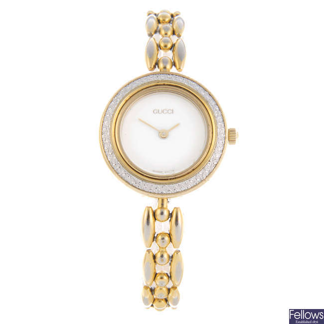 GUCCI - a lady's gold plated 11/12.2 bracelet watch with a Gucci wrist watch.