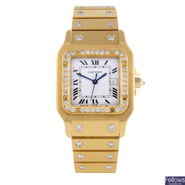 CARTIER - a yellow metal Santos bracelet watch.