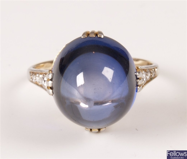 White gold mounted large cabochon sapphire ring